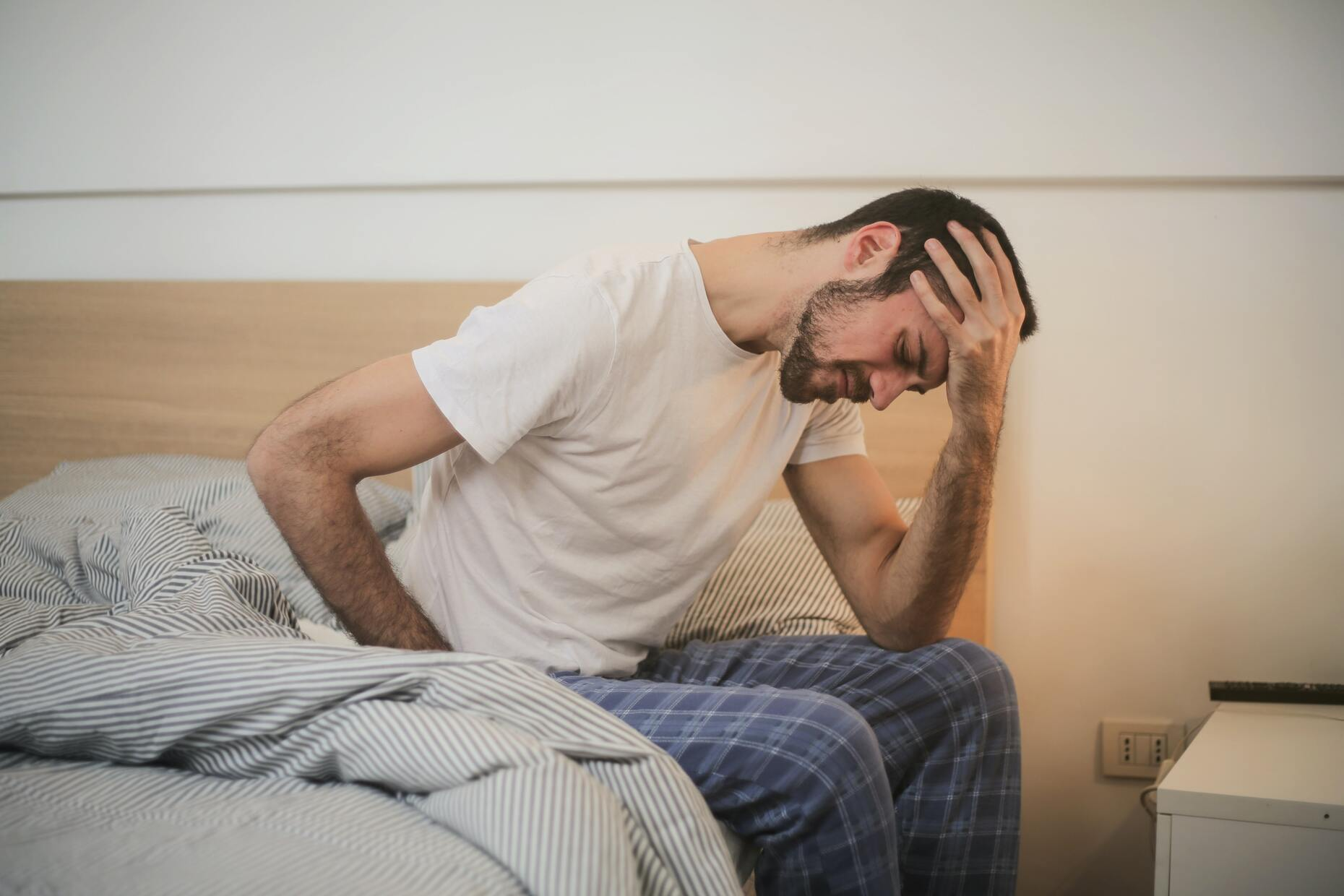 man suffering from sick house syndrome