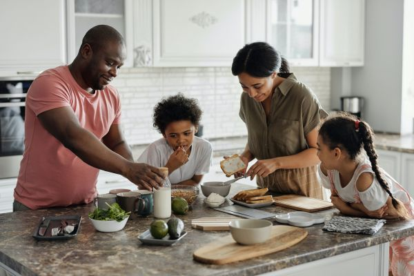 Family cook dinner together