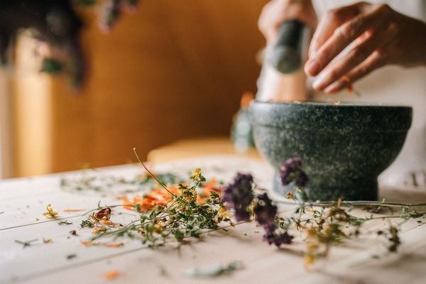 mom making home remedies with pestle and mortar