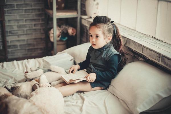Girl sitting in her bedroom