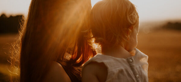 Mother and child looking at sunset